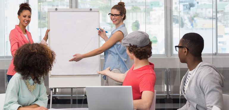 College students using soft skills to make a presentation