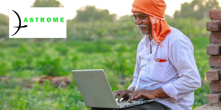 Farmer working on his laptop in the fields