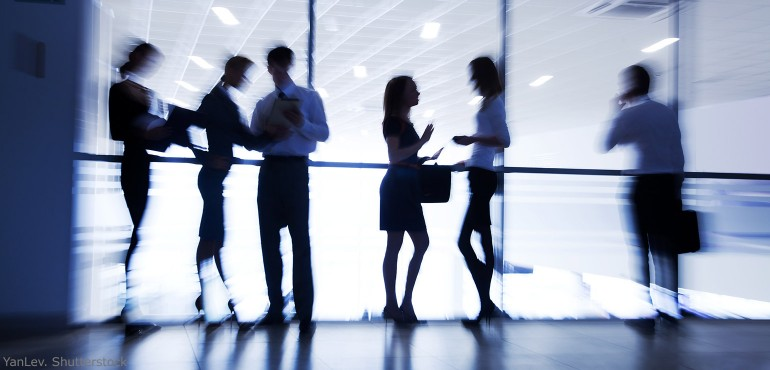 Blurred image of business people talking