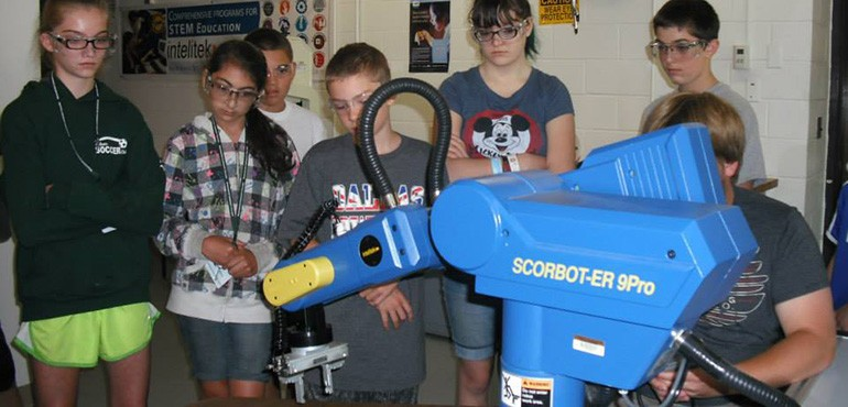 Camp kids watching robotic arm