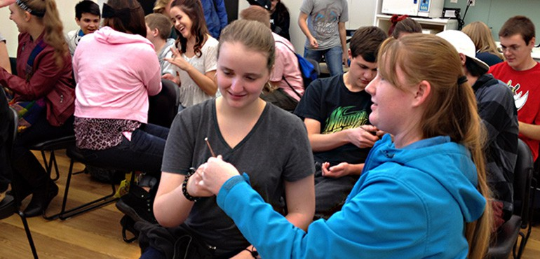 Career Path High School students practicing passing dental hygiene tools