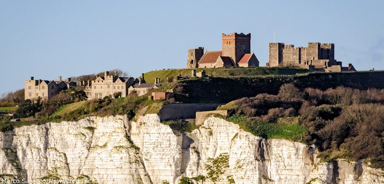Castle and houses on the cliffs of Dover England