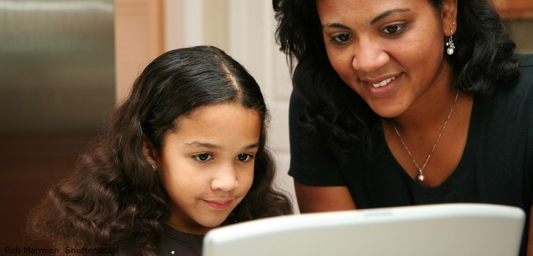 Child and parent using a laptop