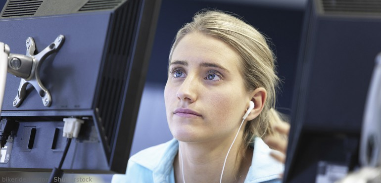 Close up of female college student looking at a computer screen