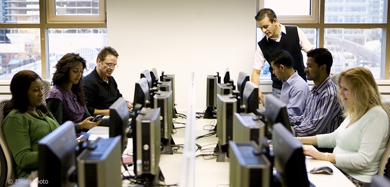 Adults learning at computers