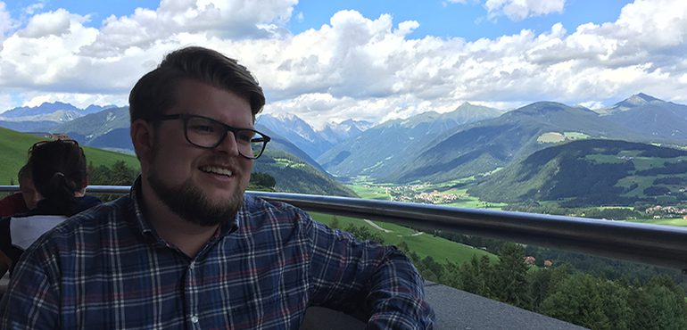 Dominik Kaltenbach with mountain scenery
