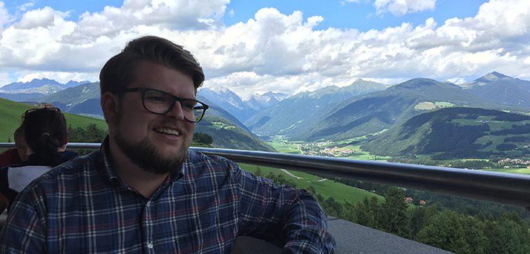 Dominik Kaltenbach with mountain scenery