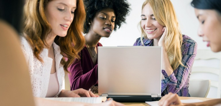 Female college students working together