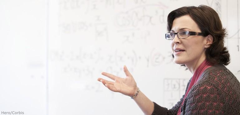Female professor lecturing in a math classroom
