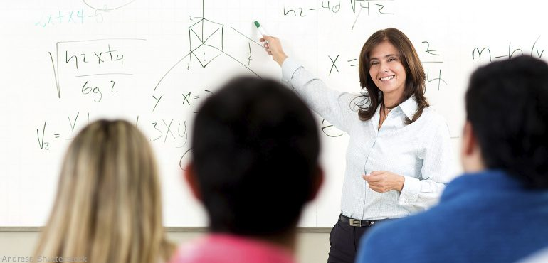 Female professor standing in front of classroom lecturing
