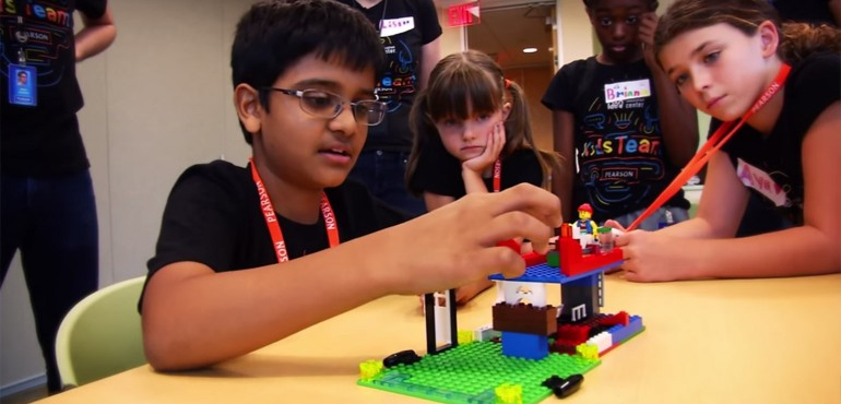 Kids CoLab members building with Legos