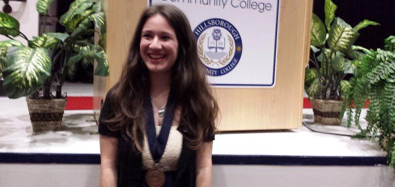 Transfer student at community college graduation