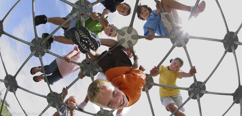 School children playing on a hexagon dome structure