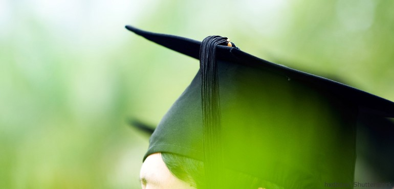 Side view of student wearing a graduation cap