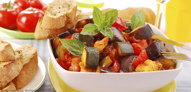 Traditional vegetable ratatouille with baguette and whole tomatoes