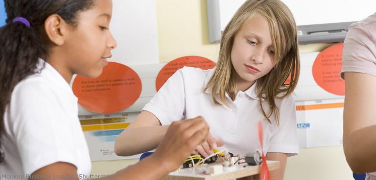 Two elementary school girls building a radio