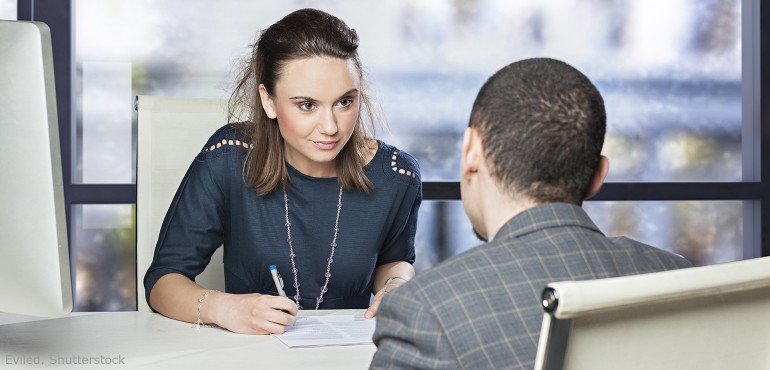 Woman interviewing male job applicant