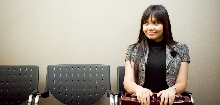 Woman sitting in chair waiting for job interview