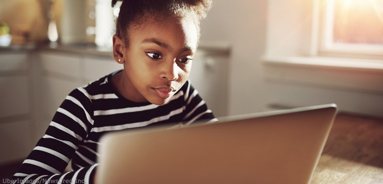 Young African American female student looking at a laptop computer