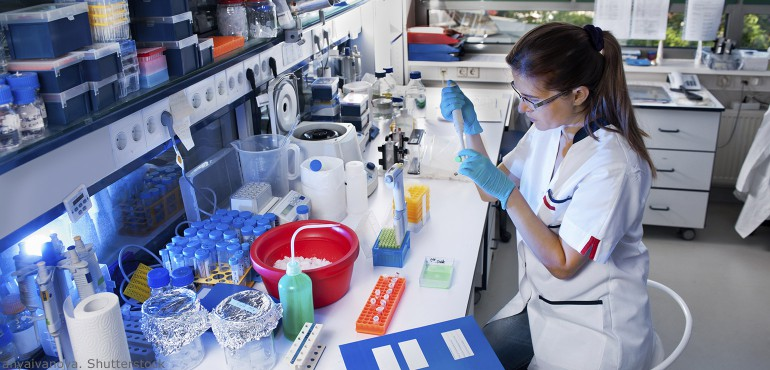 Young female scientist working in a modern biological lab