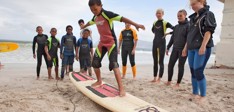 boys learning to surf