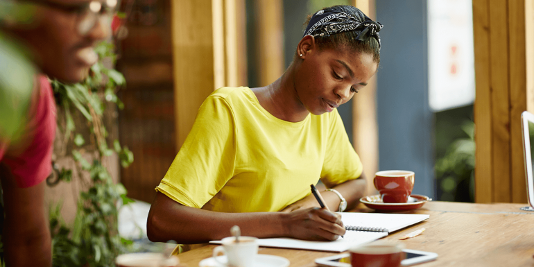 Young woman studying at coffee shop