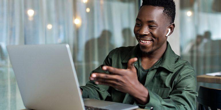 Man having a virtual meeting on his laptop