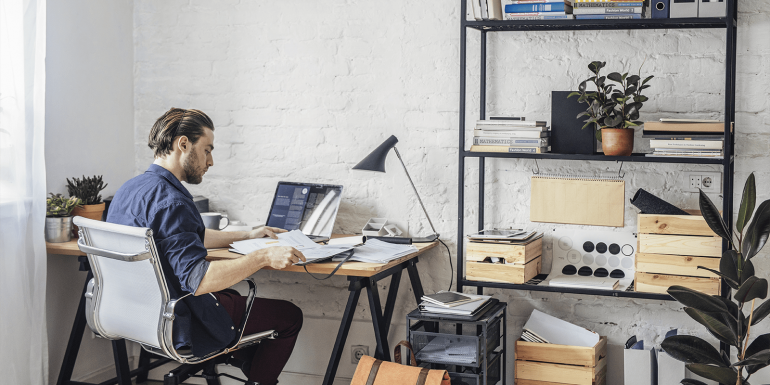 Man organizing his work from home space