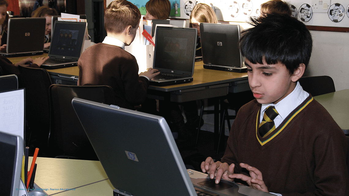 male pupil studying on a laptop