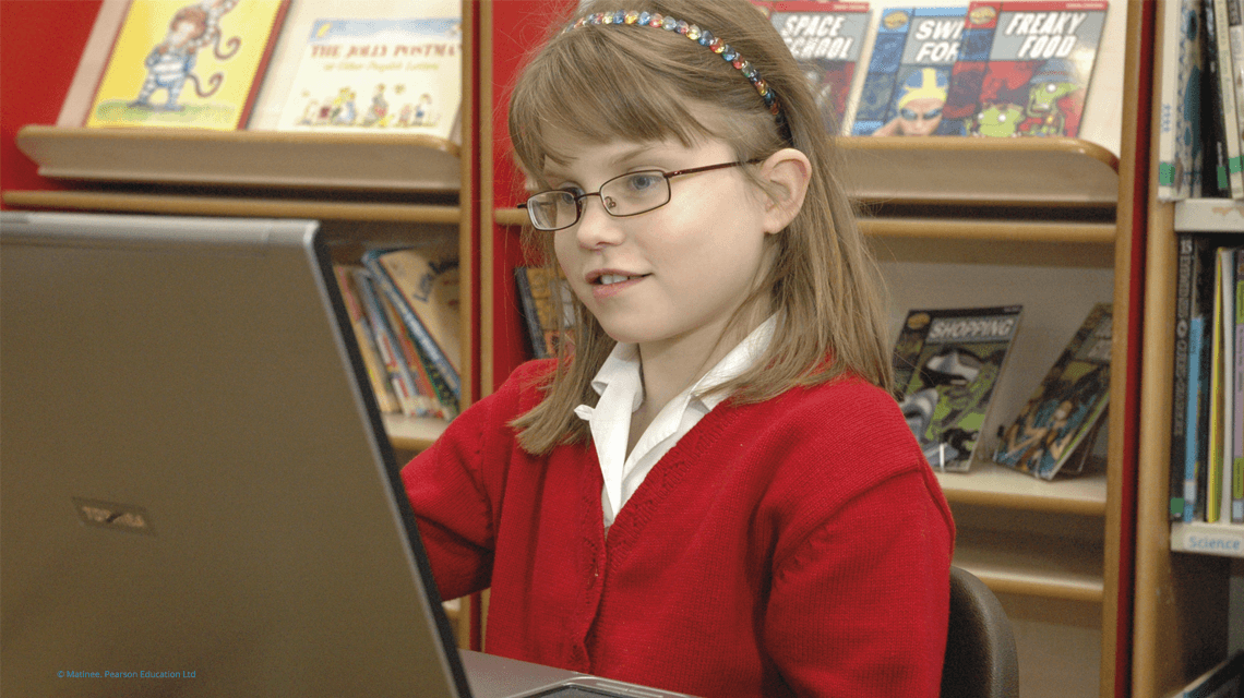 female pupil studying on a laptop